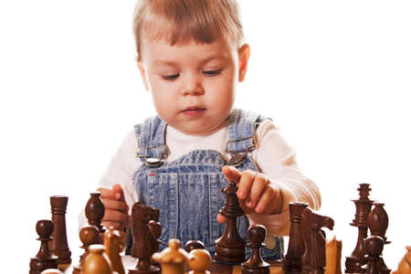 girl behind chess desk, trying to figure out where to place the chess queen. Isolated on white background.
