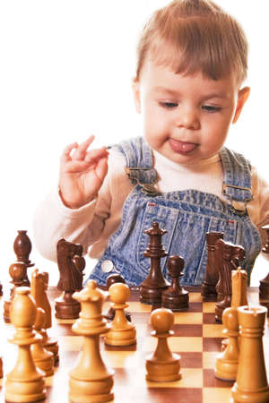 guessing:  girl behind chess desk guessing her next move. Isolated on white background. Stock Photo