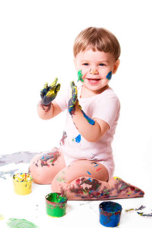 delighted: Delighted  girl painting with color cans. Isolated on white background. Stock Photo