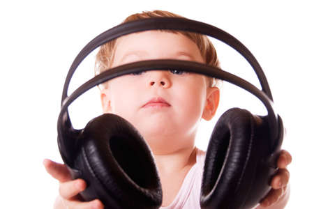 Child holding out the headphones. Isolated on white background. Stock Photo