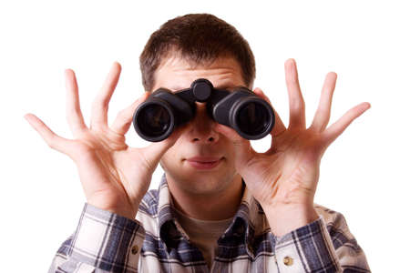 Man looking through binoculars. Isolated on white background.