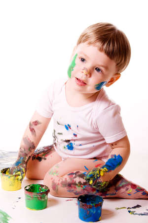 Little girl painting with hands. Isolated on white.