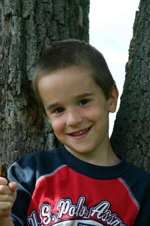 Boy leaning on tree Stock Photo - 447319