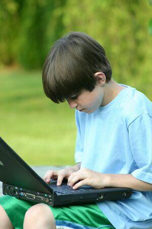 Boy Working on Laptop Stock Photo - 447301
