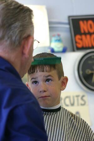 haircut: Boy getting Haircut Stock Photo