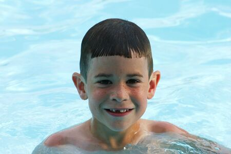 Boy having fun at pool Stock Photo - 447340