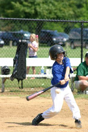 Boy Hitting Ball Stock Photo - 447302
