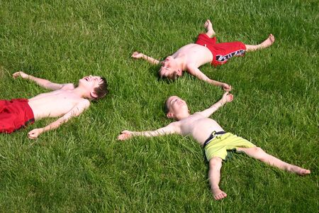 Boys Having Fun In Grass Stock Photo - 461414