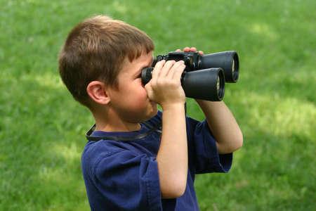 using binoculars: Boy Using Binoculars Stock Photo