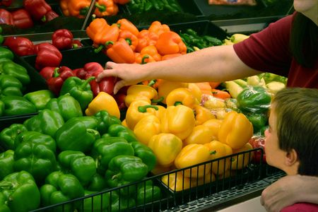bought: Woman Picking out Produce Stock Photo