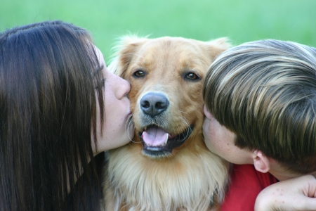Kids Kissing Dog photo