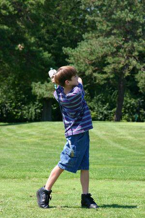 Boy Playing Golf photo