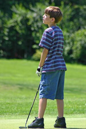 Boy Disappointed Golfing photo
