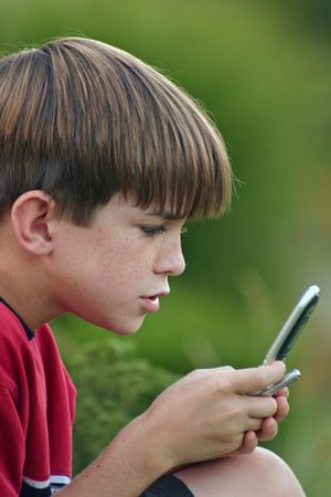 Boy playing on Cell