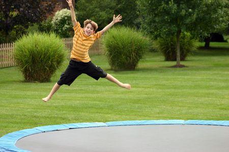 ni�o saltando: Boy Jumping  Foto de archivo