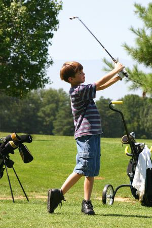 play golf: Boy golfing Stock Photo