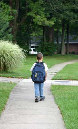 Boy Walking to Bus Stop Stock Photo - 527189