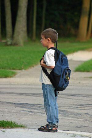 Boy Waiting at Bus Stop photo