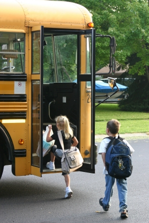 Kids Getting on Bus Stock Photo - 527186