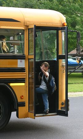 Boy Waving Getting on School Bus Stock Photo - 527187