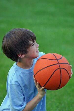 Boy Shooting A Basketball Stock Photo - 538935