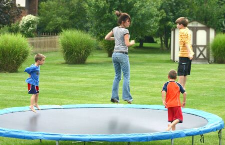 Family Jumping on Trampoline