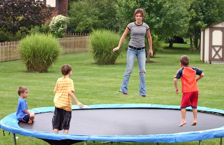 Kids Jumping on Trampoline Stock Photo - 538906