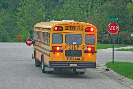 School Bus Braking at Stop Sign Archivio Fotografico