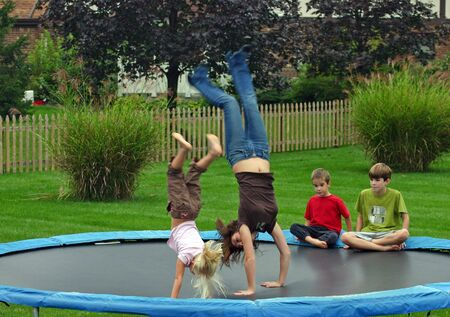 backhand: Kids Doing Backhandsprings Stock Photo