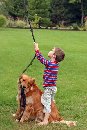 Boy Playing With Dog Stock Photo - 575116