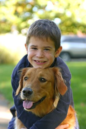 Boy Hugging Dog photo