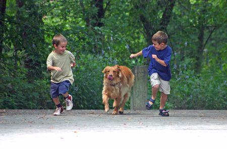 Boys Racing Dog photo