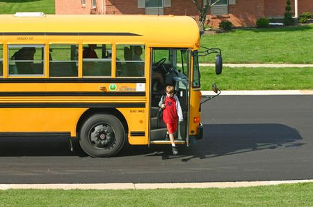 school buses: Boy Getting off Bus Stock Photo