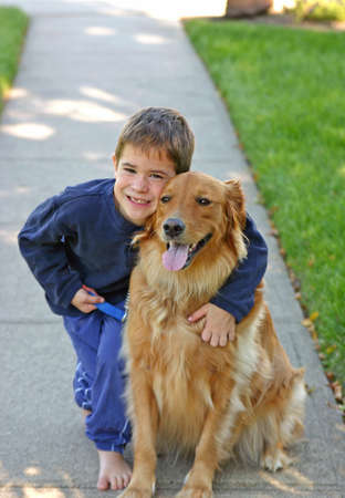 Boy Walking Dog photo