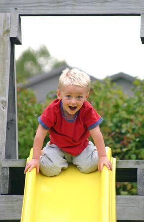 Boy on Top of Slide