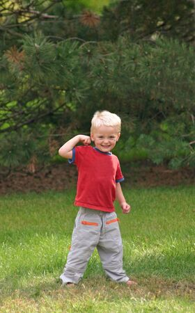 arm muscles: Boy Showing Arm Muscles