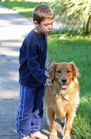 Boy Telling Dog Instructions Stock Photo - 575092