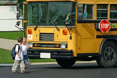 Kids Getting off Bus Stock Photo - 575086