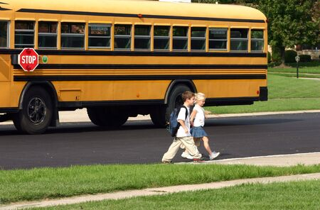 coming home: Boy and Girl Coming Home From School Stock Photo