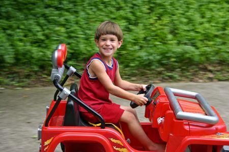 Boy Driving Jeep Fast photo