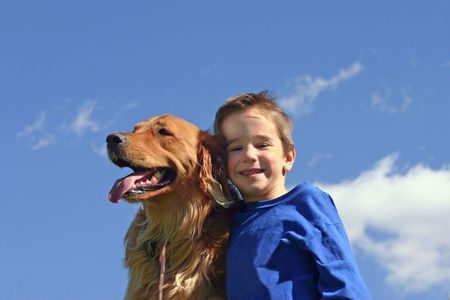 Boy and Dog in Blue Sky photo
