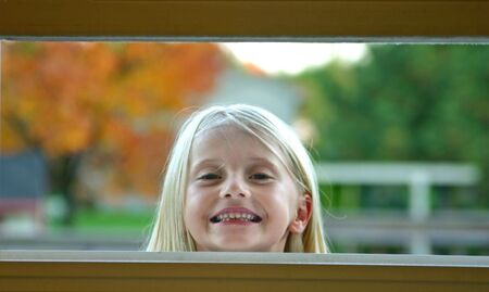 look through window: Girl Looking Through Window