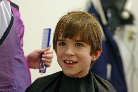 Boy Getting a Haircut Stock Photo - 639609