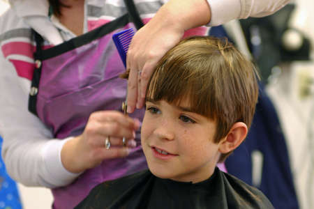 Boy Getting Haircut Stock Photo
