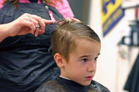 haircuts: Boy Getting Haircut Stock Photo