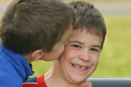 Brother Giving Kiss on Cheek Stock Photo - 685561