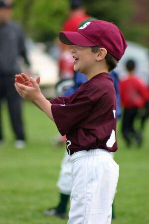 Boy Clapping at Baseball Game