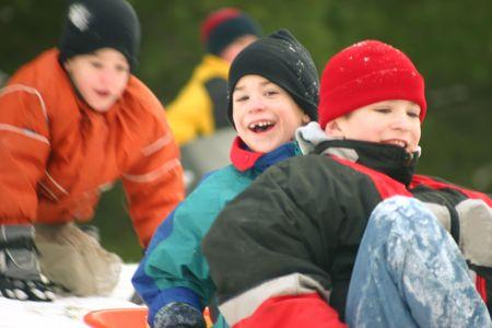 sledding: Three Boys Sledding