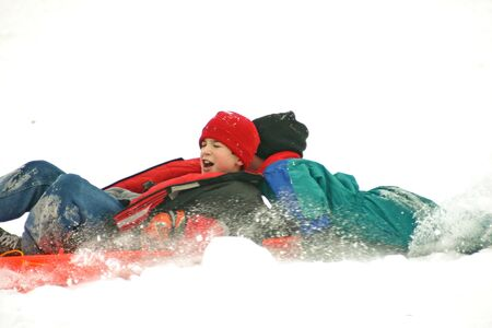 Boys Crashing while Sledding Stock Photo - 779092