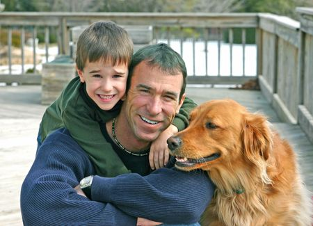 Father and son outside with the family dog